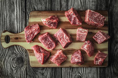 Raw angus beef slices on the old wooden table horizontal Royalty Free Stock Photography
