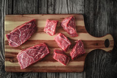 Raw angus beef slices on the wooden board top view Royalty Free Stock Photos