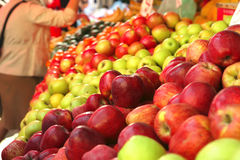 Raw apple heaps perspective. On market show tray Stock Images