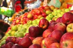 Raw apple heaps perspective. On market show tray Stock Photo