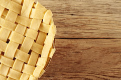 Raw apple pie closeup. On wooden background with copy space Royalty Free Stock Photography