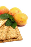 Raw apricot and tasty cake Stock Images