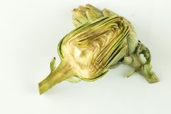 Raw artichoke cut in half royalty free stock photography