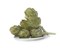 Raw Artichokes on a Plate Royalty Free Stock Images