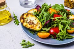 Raw arugula with vegetables. And citrus. Selective focus Stock Photos