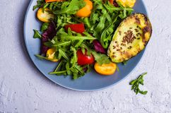Raw arugula with vegetables. And citrus. Selective focus Royalty Free Stock Images