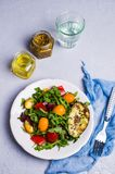 Raw arugula with vegetables. And citrus. Selective focus Royalty Free Stock Photography