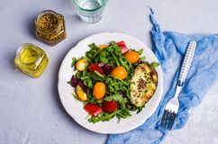 Raw arugula with vegetables. And citrus. Selective focus Royalty Free Stock Image