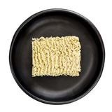 Raw Instant Ramen Noodles in Black Bowl Top View Isolated Royalty Free Stock Photos