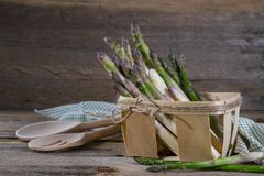 Raw asparagus in a basket with copy space in the background, selected focus. Stock Image