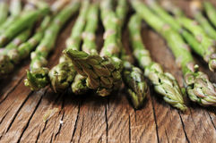 Raw asparagus on a rustic wooden table, filtered Stock Photography