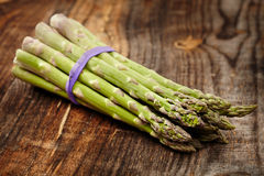 Raw asparagus on wooden board Royalty Free Stock Photos