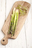 Raw asparagus on a wooden board Royalty Free Stock Photography