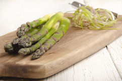 Raw asparagus on a wooden board Stock Photography