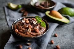Raw avocado chocolate mousse with hazelnuts Stock Image