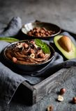 Raw avocado chocolate mousse with hazelnuts Stock Photos