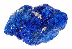 Raw azurite (chessylite) stone on white. Macro photography of natural mineral from geological collection - raw azurite (chessylite) stone on white background stock images