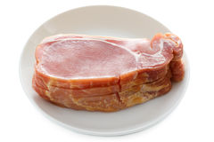 Raw back bacon slices isolated on white Stock Photography