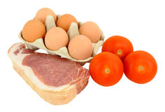 Raw Bacon With Eggs And Tomatoes Stock Photos