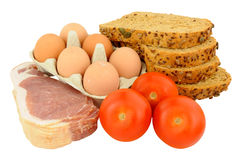 Raw Bacon With Eggs And Tomatoes Stock Images