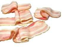Raw bacon isolated on white background,. Raw meat, Raw bacon isolated on white background, Brisket, bacon strips, cooking food, Prosciutto,Top view, Slices Royalty Free Stock Photos