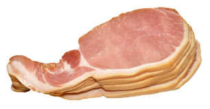 Raw Bacon Rashers. Pile of raw uncooked back bacon rashers, isolated on a white background Royalty Free Stock Images