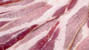 Raw Bacon Strips Rotating stock video