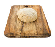 Raw ball of dough on wooden board isolated on white. Background Royalty Free Stock Photos