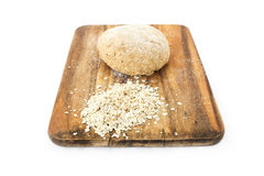 Raw ball of dough on wooden board. On white background Royalty Free Stock Images