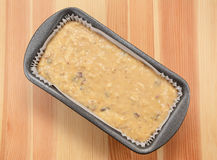Raw banana loaf batter in a lined tin Royalty Free Stock Images