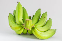Raw bananas on background. Royalty Free Stock Images
