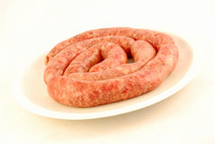 Raw barbecue sausages Stock Images