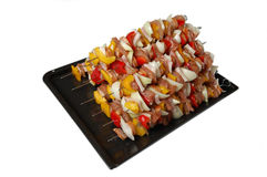Raw barbecue spits ready for cooking Royalty Free Stock Image