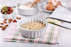 Raw batter for almond cake and ingredients for baking royalty free stock images