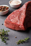 Fresh beaf meat. Raw beaf meat and  spices over stoun table Stock Photography