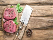 Raw beaf steaks with spices. Royalty Free Stock Photo