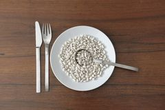 Raw beans in a dish Stock Image