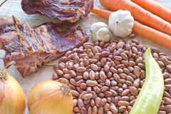Raw beans with smoked pork meat and vegetables Royalty Free Stock Image