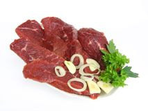 Raw Beef. Cutlets of raw beef with garnish Stock Photography