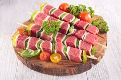 Raw beef on board. Close up on raw beef on board Royalty Free Stock Photos