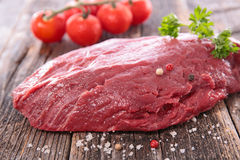 Raw beef on board. Close up on raw beef on board Stock Photography
