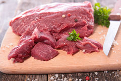 Raw beef on board. Close up on raw beef on board Stock Image
