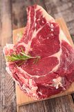 Raw beef on board. On wood background Royalty Free Stock Photo