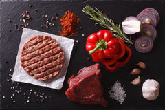 Raw beef Burger cutlets with ingredients. horizontal top view cl. Raw Ground beef meat Burger steak cutlets with ingredients on the board. horizontal view from Stock Images