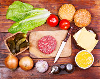 Raw beef burger for hamburger with vegetables Royalty Free Stock Photography