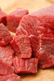 Raw beef cubes. Raw fresh beef cubes on board closeup Royalty Free Stock Images