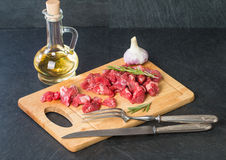 Raw beef cubes. With rosemary and beefsteak spices on wooden cutting Board Stock Image