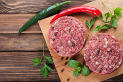 Raw beef cutlets with spices Royalty Free Stock Photo