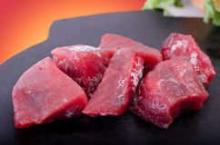Raw beef on cutting board. Fresh beef with chunks of ice on the cutting Board Stock Images