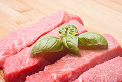 Raw beef on cutting board Stock Image